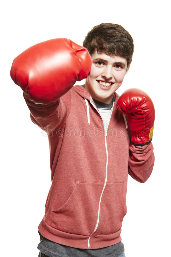 Young Teenage Boy Wearing Boxing Gloves Smiling Stock Image - Image 30583671-4931