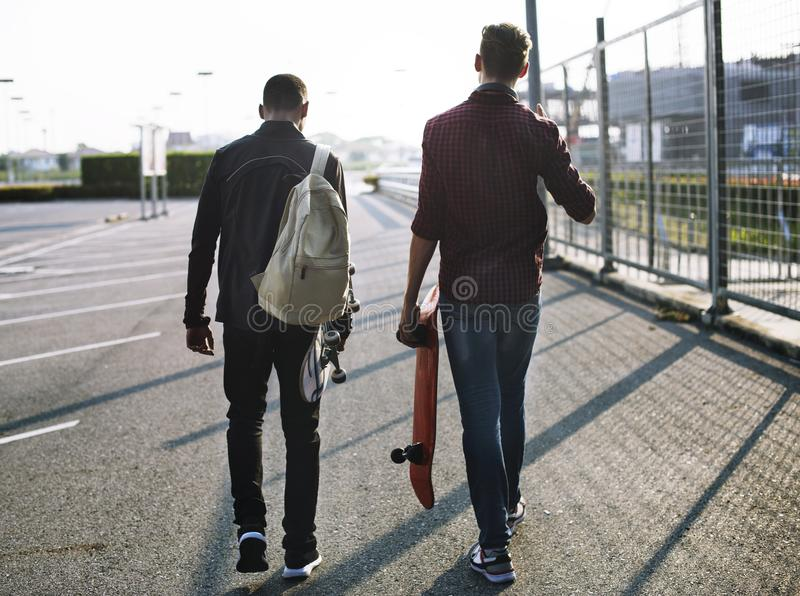 Young teenage boys with skateboards stock images