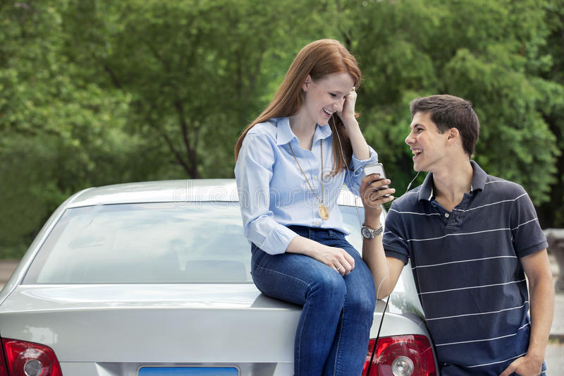 Young teenage drivers with car. Teenagers with car in park stock images