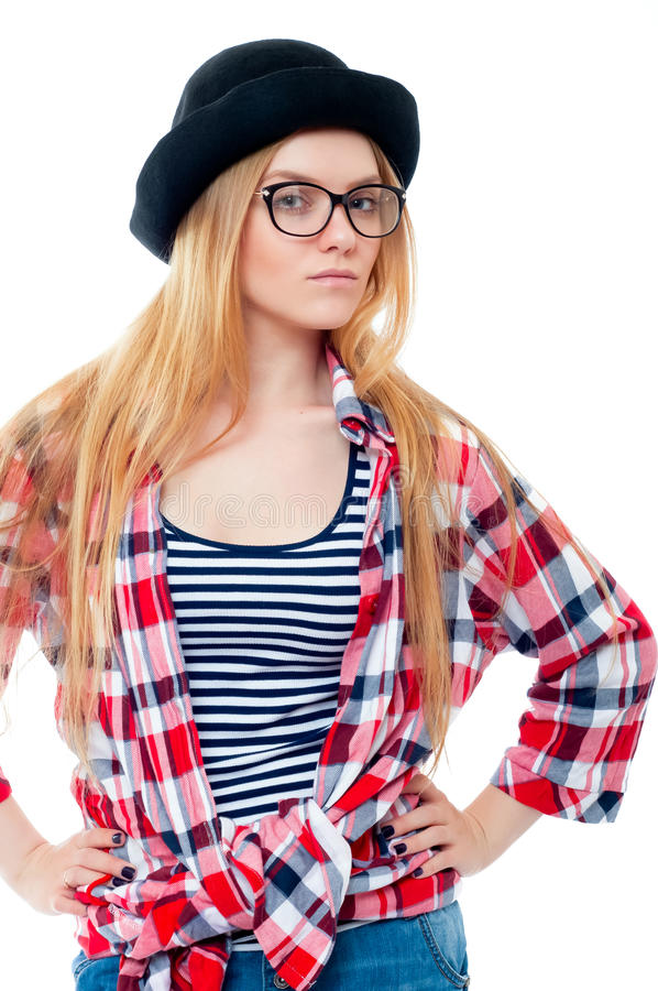 Young teenage girl in black hat, glasses and colorful clothes royalty free stock images