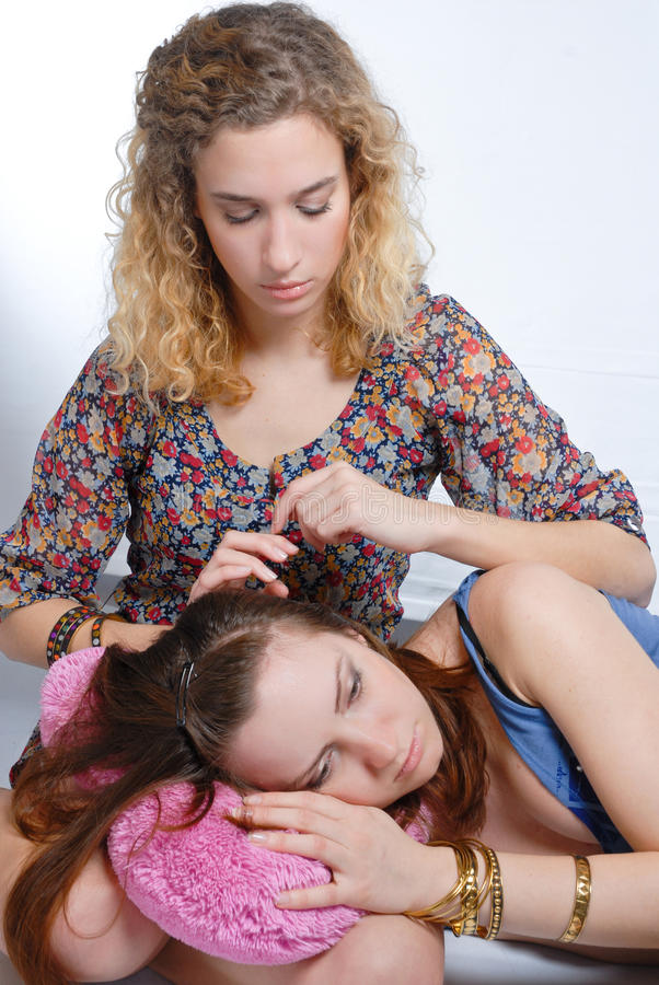Download Young Teenage Girl Comforting Her Friend Stock Image - Image: 12567279