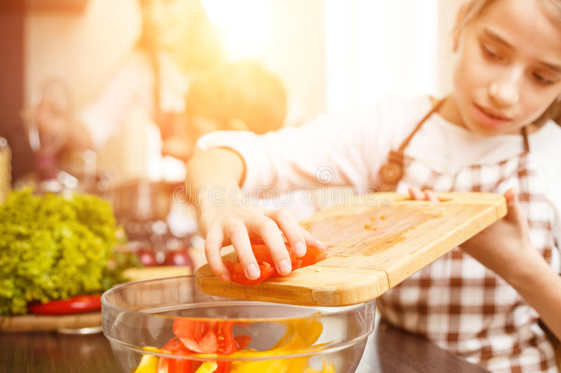 Young teenage girl cook together with her family royalty free stock images