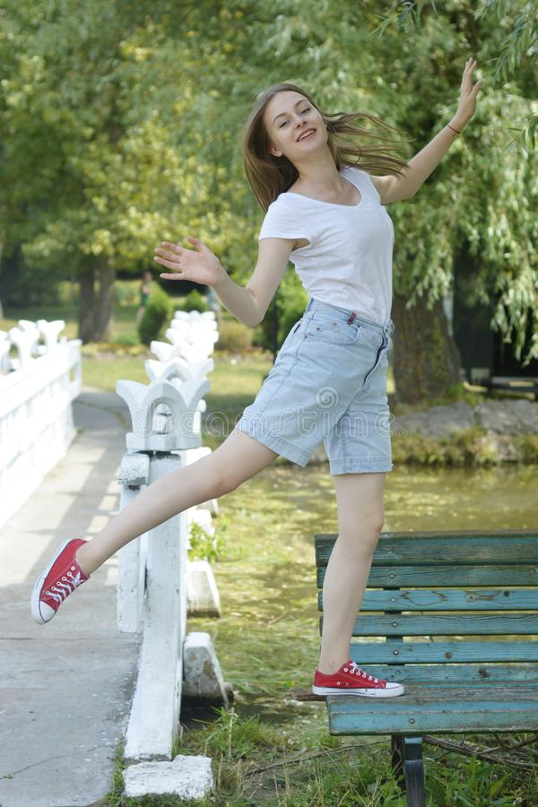 Free Young Teenage Girl Having Fun In The Park, On A Bench. Education, School Girl. Smiling Young Woman. Summer Holidays Royalty Free Stock Image - 156078156