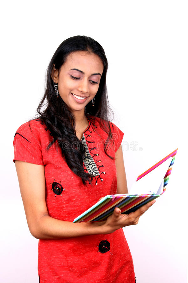 Download Young Teenage Girl Holding A Book. Stock Photo - Image: 12003604