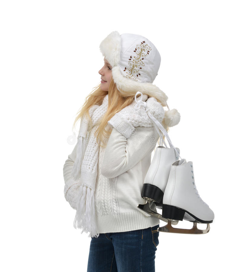Young teenage girl holding ice skates for winter ice skating sport stock photo
