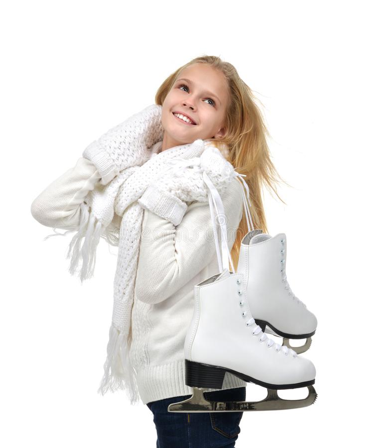 Young teenage girl holding ice skates for winter ice skating sport activity smiling stock images
