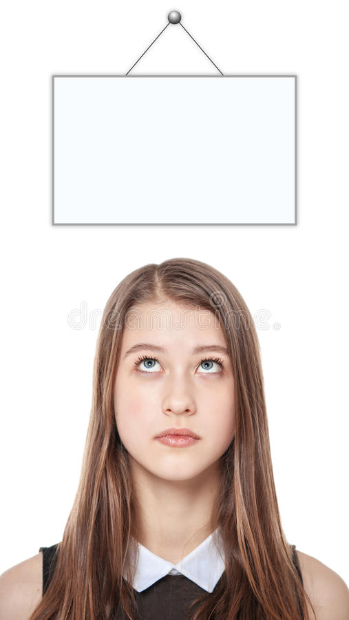 Young teenage girl looking up on empty picture frame isolated royalty free stock photos