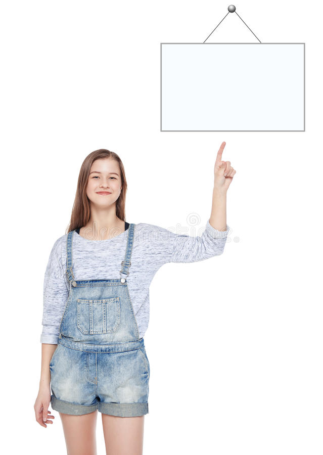 Young teenage girl showing on empty picture frame by finger royalty free stock photo