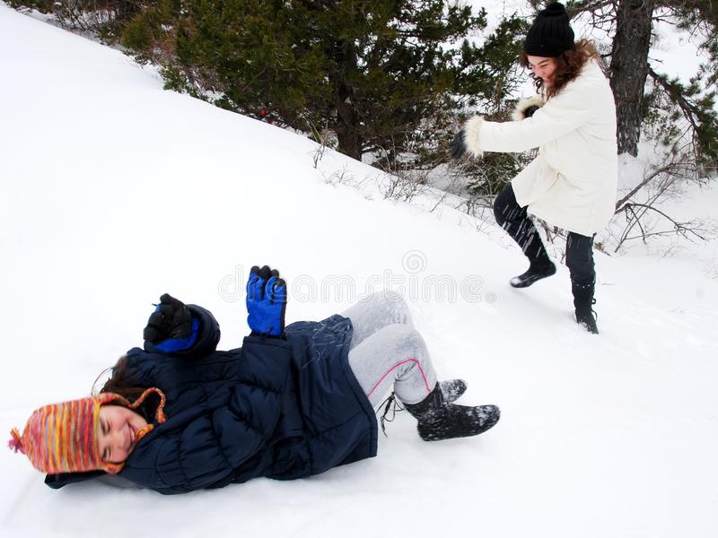 Young teenage girls playing snow games stock images