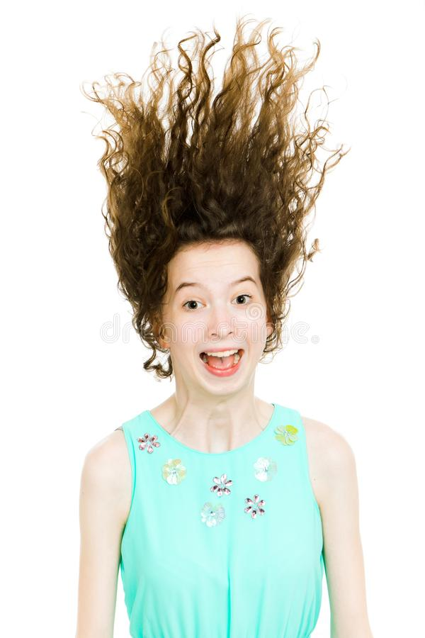 Young teenaged blonde girls wearing turquoise dress making fun with hairs - flying up royalty free stock photos