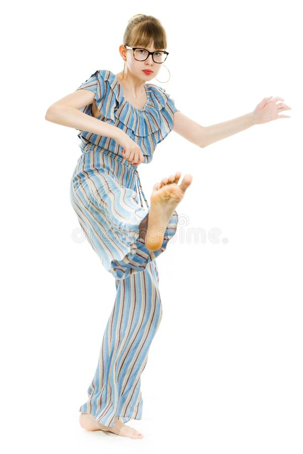 Young teenaged girls wearing jumpsuit dress with gaps texture - direct kicks stock photography
