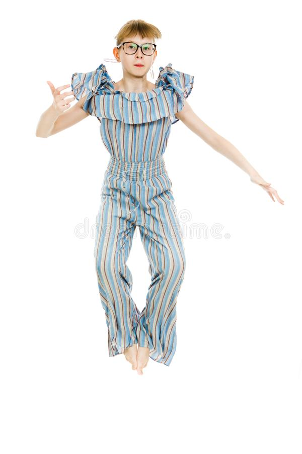 Young teenaged girls wearing jumpsuit dress with gaps texture - jumping high stock photos