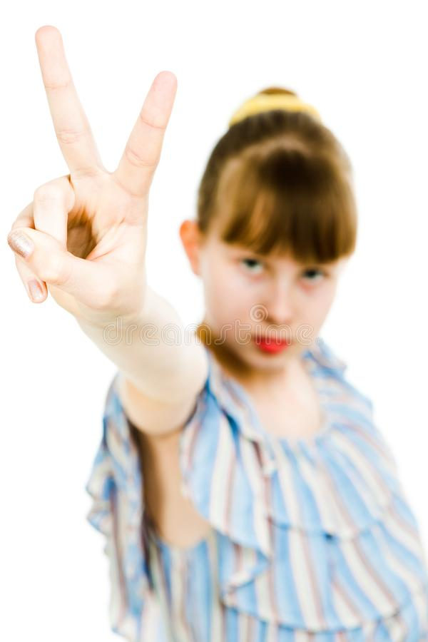 Young teenaged girls wearing jumpsuit dress with gaps texture - victory gesture stock photo