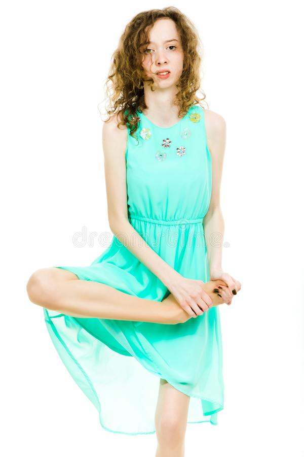 Young teenaged girls wearing turquoise dress - hurt foot stock photo