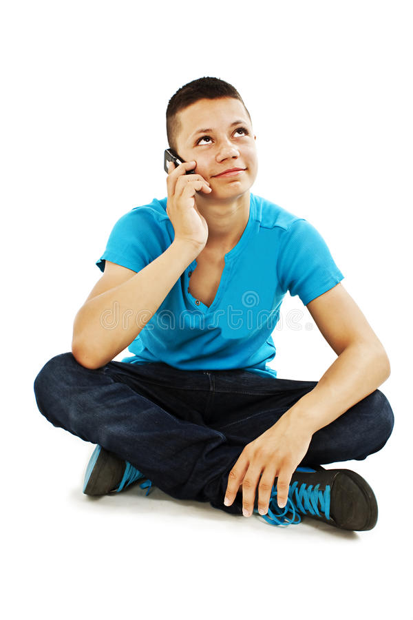 A young teenager boy on the cell phone looking up stock photos