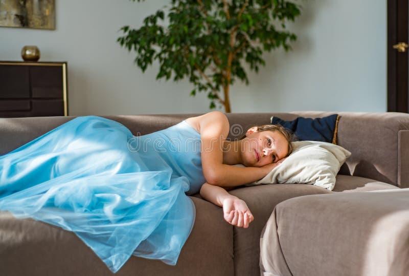 Teenager brunette girl with long hair lying on sofa at home. Young teenager brunette girl with long hair lying on sofa at home stock images