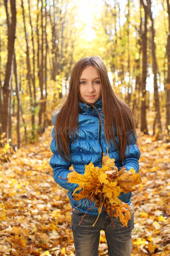 Download Young Teenager Girl In The Autumn Forest Stock Photo - Image of female, expression: 16724344