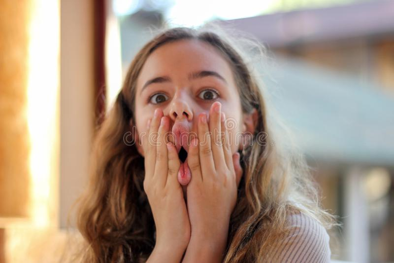 Young teenager girl fooling around and making funny faces stock photo