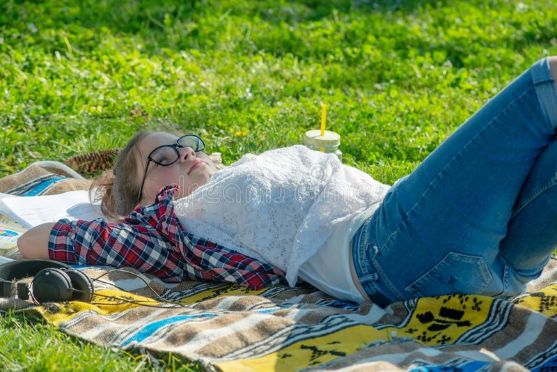 Young teenager girl lying in the grass royalty free stock photo