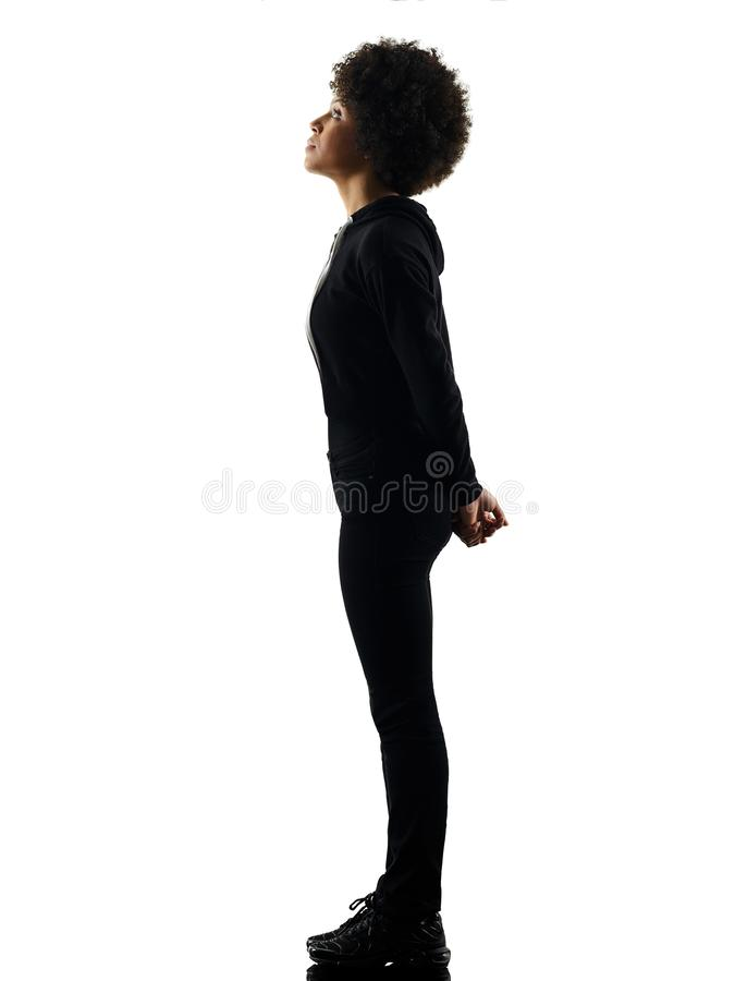 Young teenager girl woman standing looking up shadow silhouette stock photo