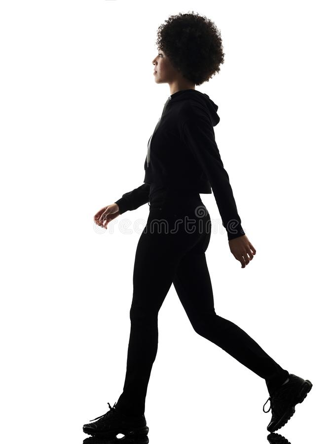 Young teenager girl woman walking shadow silhouette isolated stock photos