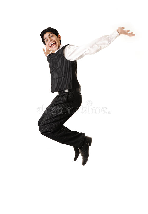 Young teenager jumping in joy royalty free stock photo