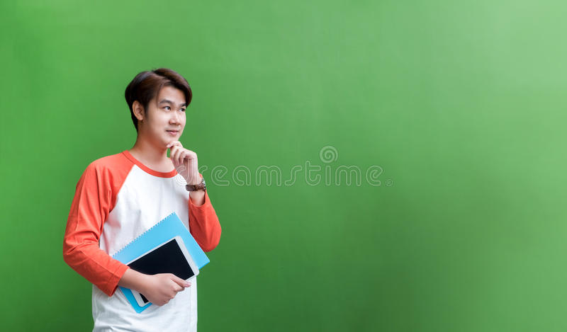 Young teenager man holding tablet computer and notebook and thin stock images