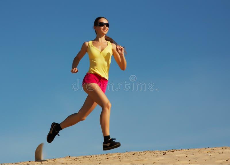 Young teenager running stock photos