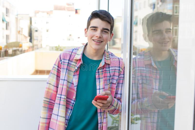Teenager on the street with mobile phone. Young or teenager on the street with mobile phone royalty free stock images