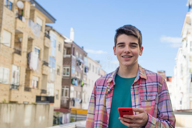 Teenager on the street with mobile phone. Young or teenager on the street with mobile phone stock image