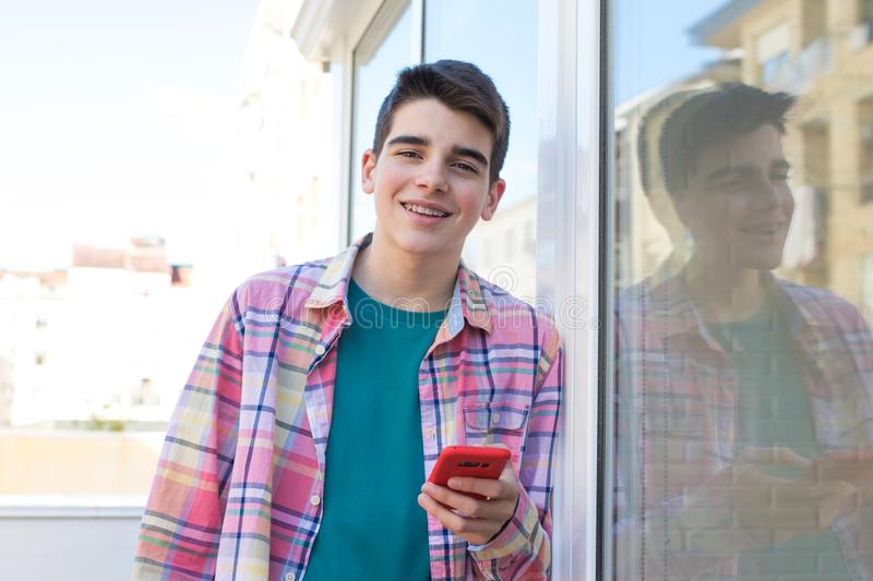 Teenager on the street with mobile phone. Young or teenager on the street with mobile phone royalty free stock photos
