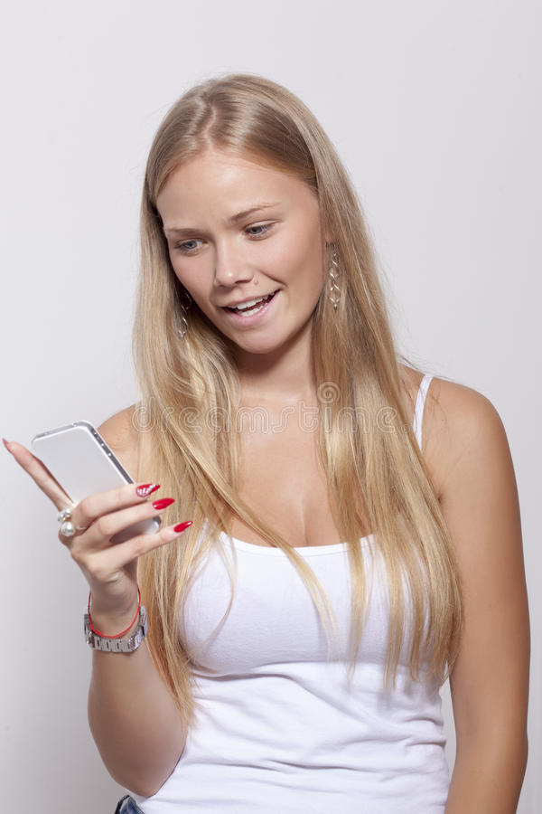 Young Teenager Woman hold smartphone phone royalty free stock photography