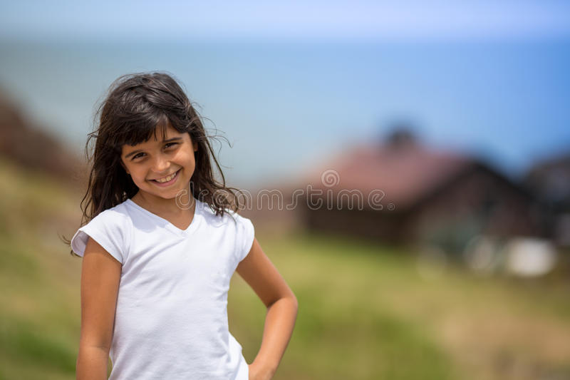 Young teengirl at beach with blurry hut royalty free stock photo