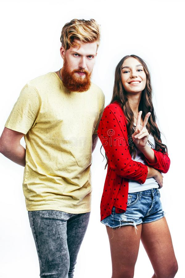 Young tender couple, man and woman in love isolated on white, fooling around real modern hipster marriage, lifestyle. Young tender couple, men and women in love royalty free stock photography