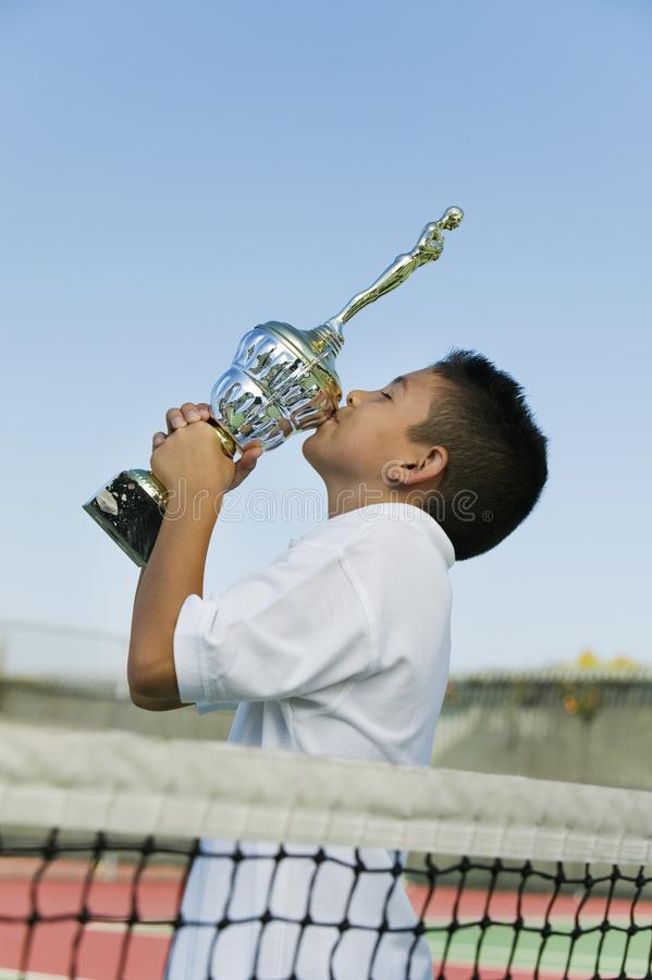 Download Young Tennis Player On Court Kissing Trophy Stock Image - Image: 13584269