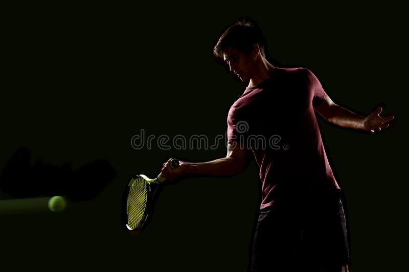 Young Tennis player ready to hit the ball royalty free stock image