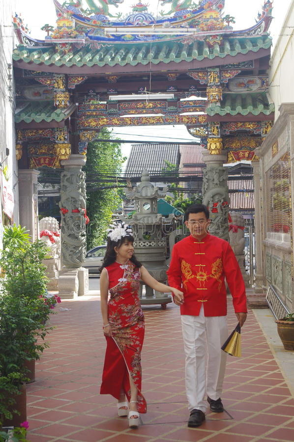 Young Thai couple. In Buddhist temple in Thailand stock photography