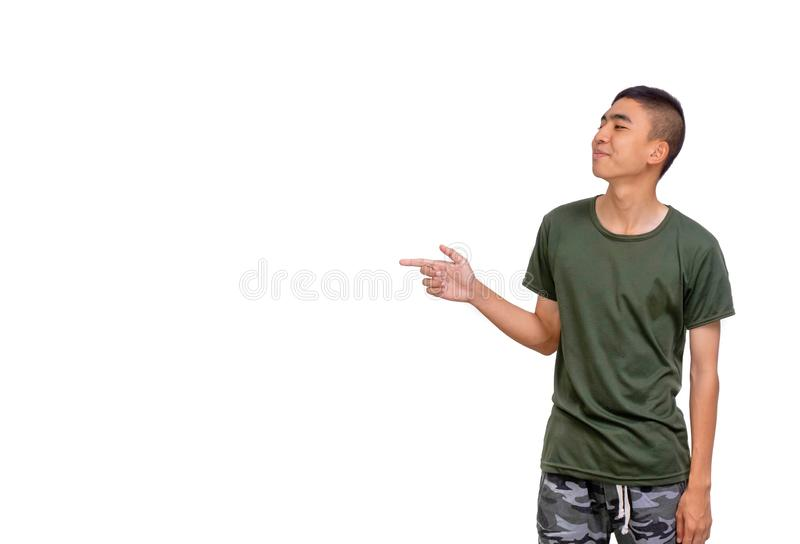 Young Thai man points to his right side copyspace. The Young Thai man points to his right side copyspace royalty free stock photos