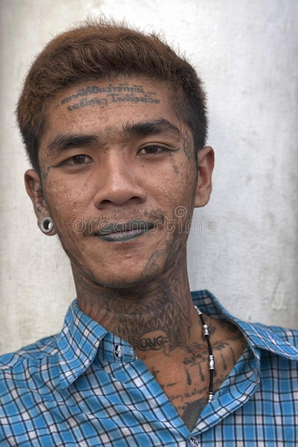 Young Thai man. With tattoos on his head, lips and neck stock images