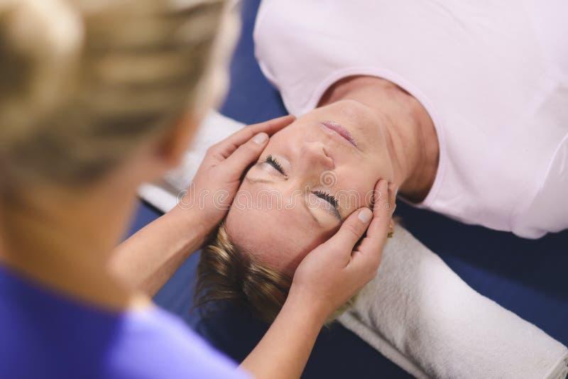 Download Young Therapist Doing Reiki To Senior Woman Royalty Free Stock Photos - Image: 27883008
