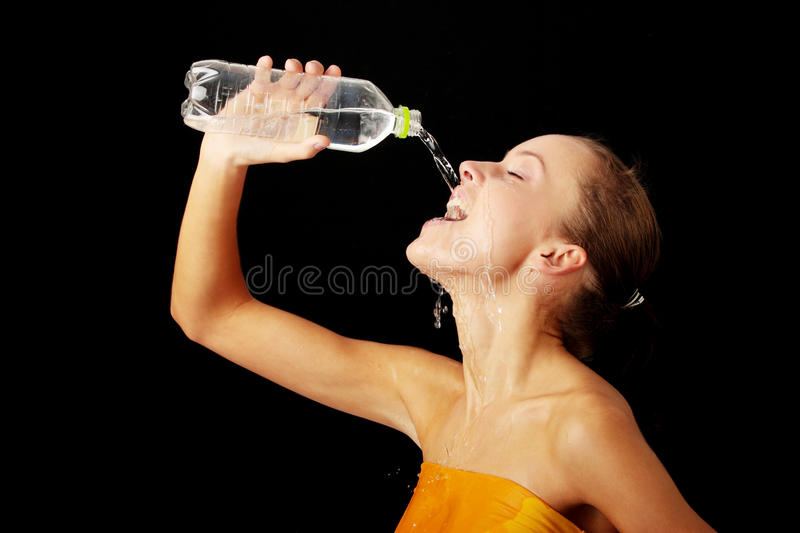 Young thirsty girl stock image