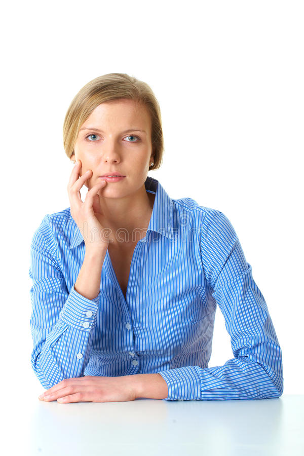 Young thoughtful female in blue shirt isolated royalty free stock images