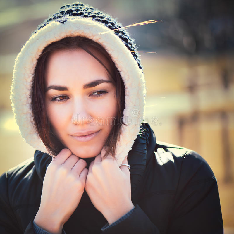 Young thoughtful woman in hood royalty free stock photos