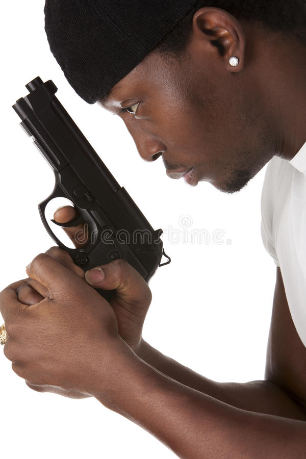 Download Young thug with a gun stock photo. Image of background - 24400962