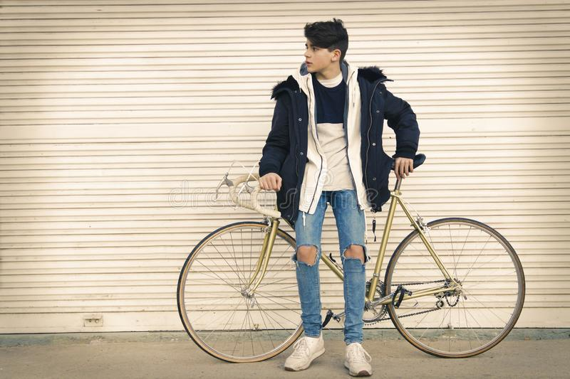 Young to the fashion with the bicycle in the street stock images