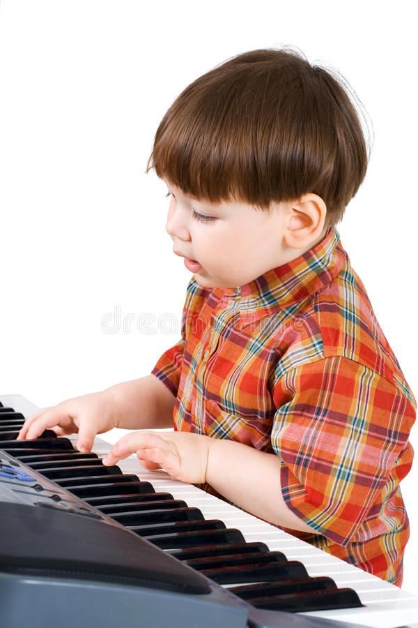 Download Young Toddler Stu To Play Music Stock Photo - Image: 9917038