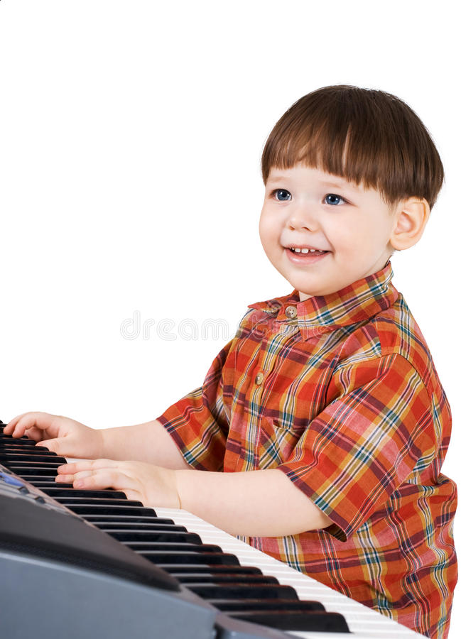 Young toddler stu to play music stock images