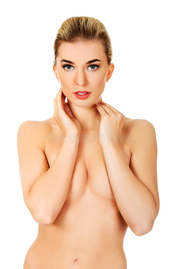 Young topless woman touching her face. stock image