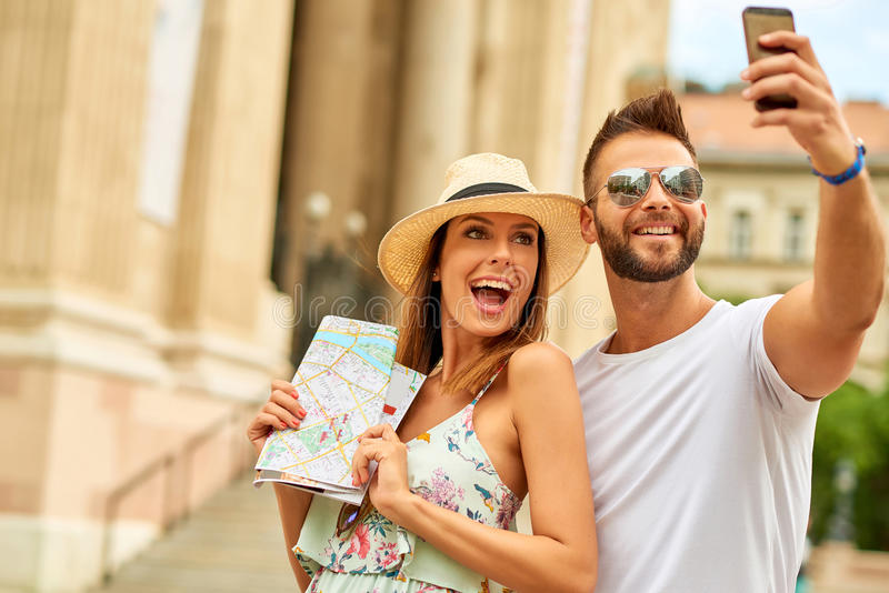 Young tourist couple. A beautiful young couple are taking a selfie at the St. Stephens Basilica in Budapest, Hungary royalty free stock photography
