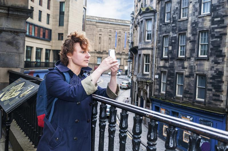 A young tourist girl takes pictures stock photo